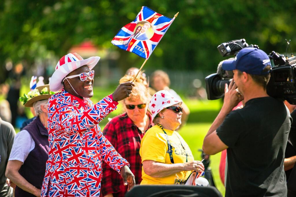 Black man holding British Flag during the royal wedding